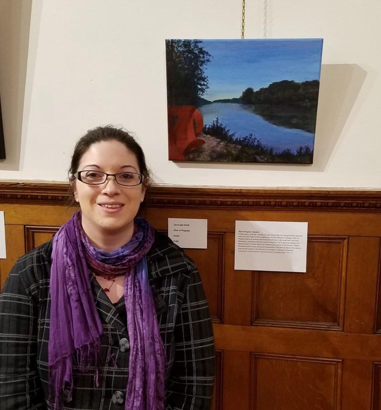 Photo of artist Laura Jaen Smith in front of acrylic painting River of Progress at opening reception Tioga Arts Council Owego NY