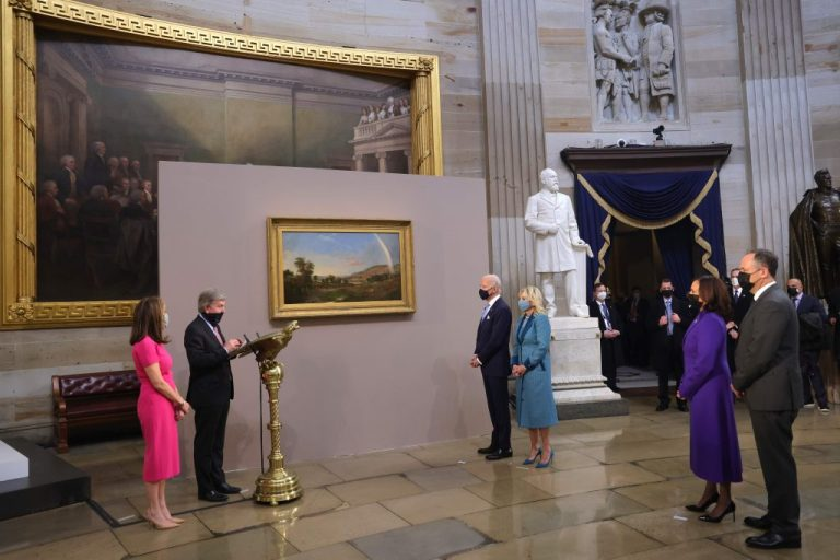 Photo US President Joe Biden and First Lady Jill Biden are presented with Landscape with Rainbow by Robert S. Duncanson from US Senator Roy Blunt. January 20, 2021 in Washington, DC.