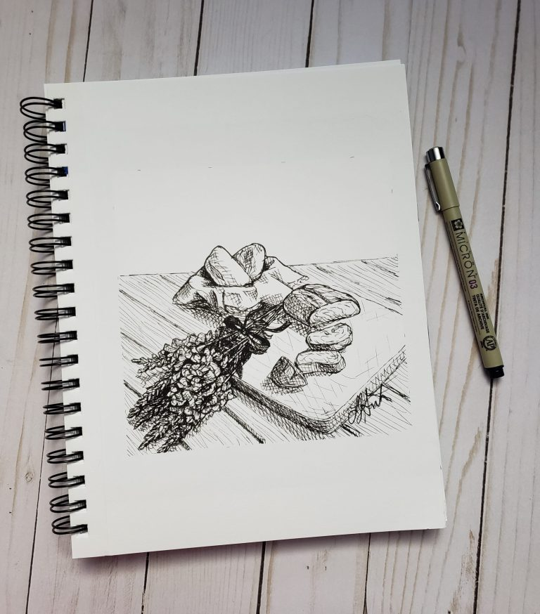 Inktober day 4 ink drawing challenge. Table with basket of bread, bread sliced on cutting board, hand bouquet of snapdragons.