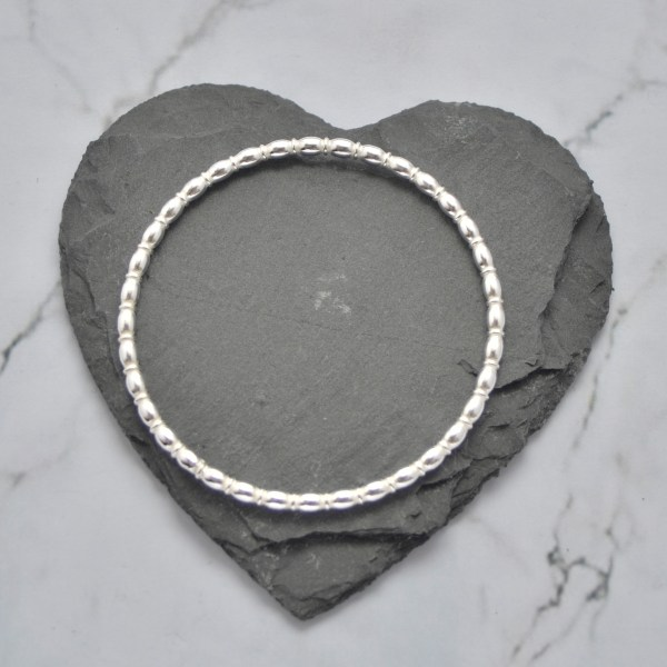 Oval beaded solid silver ladies bangle by Laura Llewellyn Design