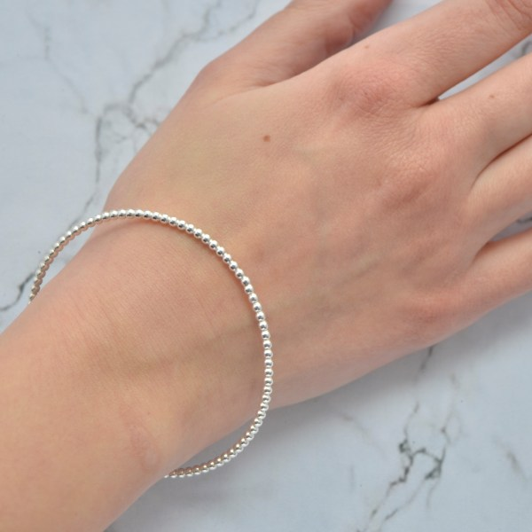 Solid silver stacking bangle by Laura Llewellyn Design