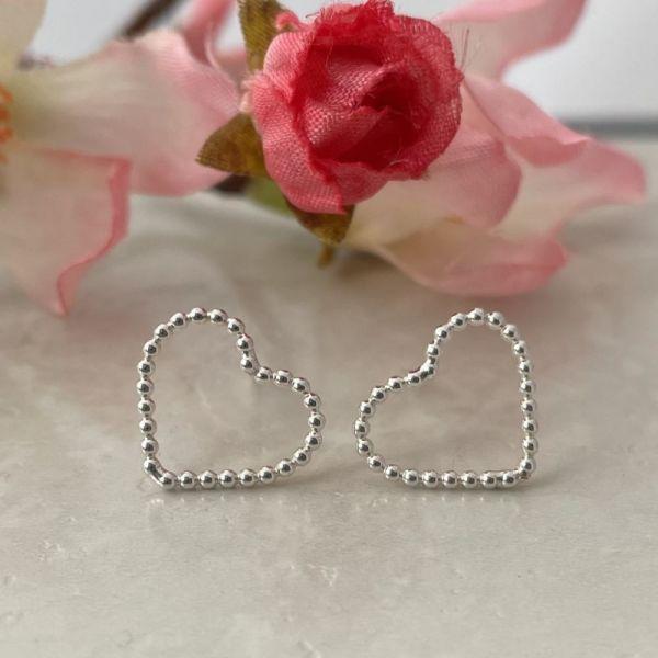Heart earrings handmade in silver by Laura Llewellyn Design
