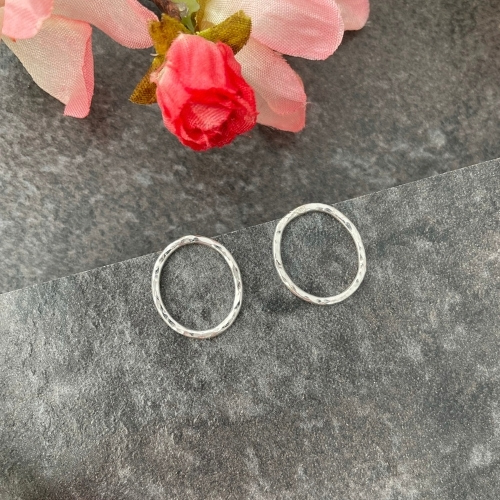 Silver hammered oval stud earrings