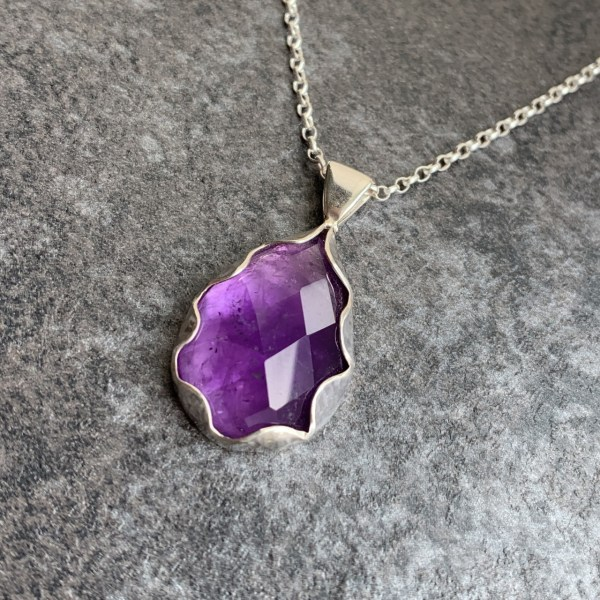 Silver and amethyst gemstone pendant