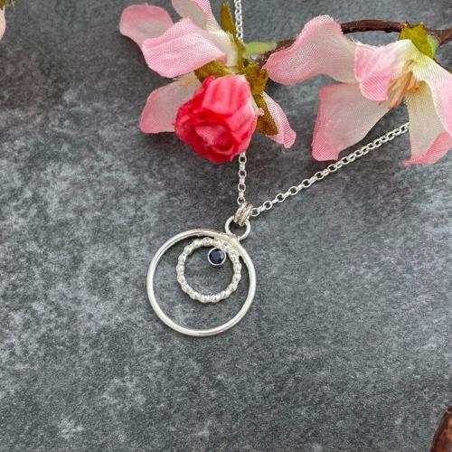 Handmade silver pendant set with blue sapphire gemstone