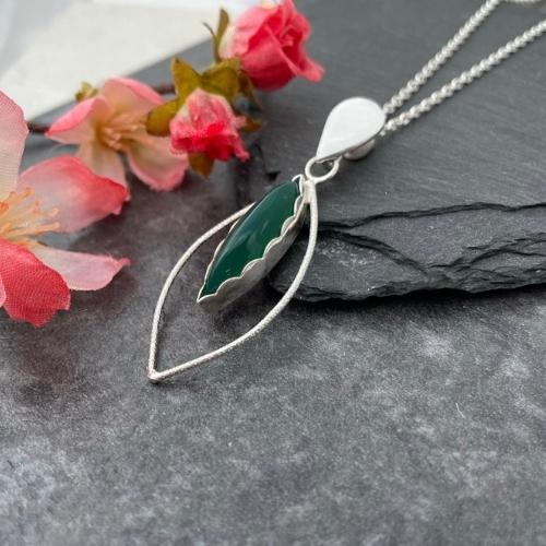 Green jade pendant handmade in silver