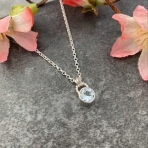 Blue topaz gemstone silver pendant