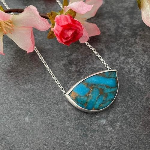 Turquoise gemstone pendant set in a handmade silver pendant
