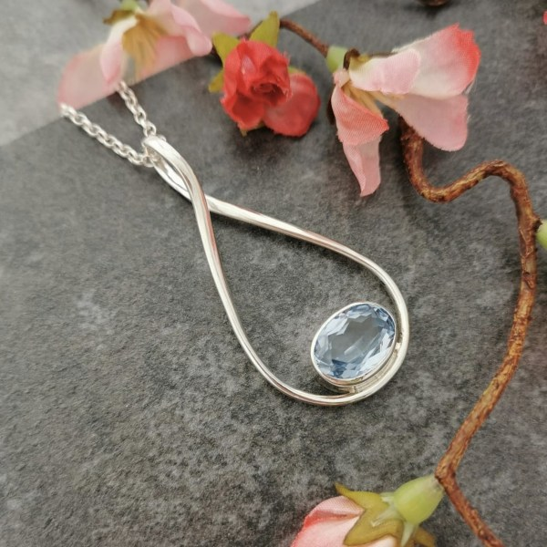Blue topaz gemstone pendant set in silver