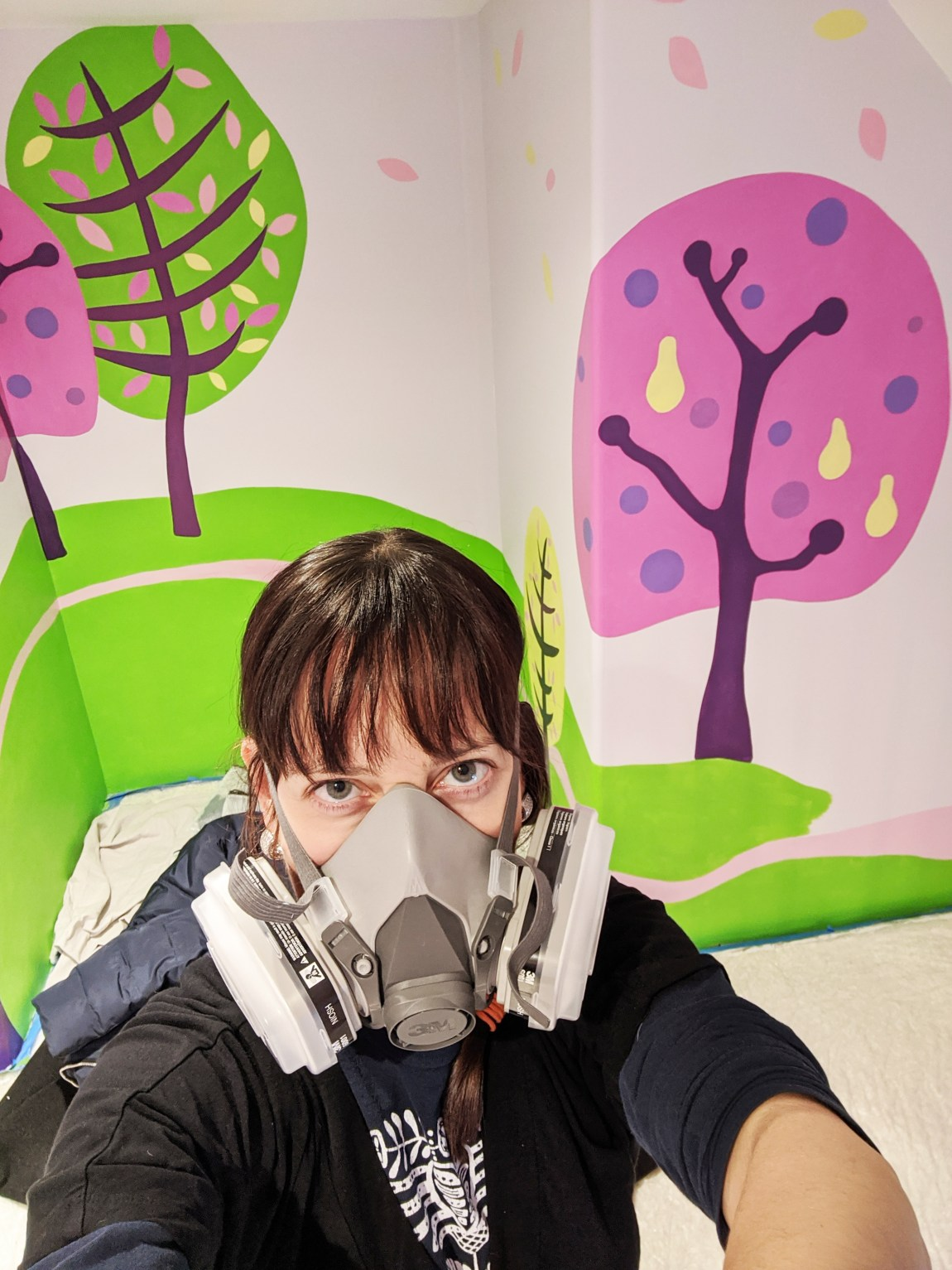 Laura Lynne Art working on a mural
