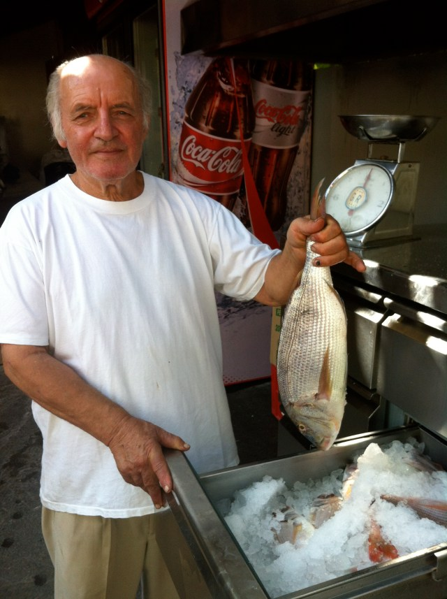The owner of Faro showing us the fish he would grill for our seaside lunch, Crete