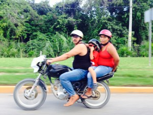 A Local Family driving in the Riviera Maya
