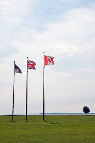 You can see Canada from the island. Flags of the U.S., Great Britain and Canada.
