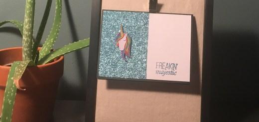 Rainbow unicorn on glitter background freakin majestic card