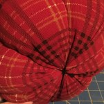 bottom of pumpkin with yarn tied tight