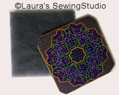 To add more loft to the applique, sandwich one or two layers of batting behind the stabilizer.