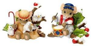 Two mice in ancient middle eastern clothing, one holding birds, the other drumming a blue and red drum.