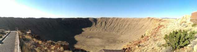 wide angle of enormous crater in desert