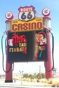 giant fake old-style gas pumps support Route 66 casino sign