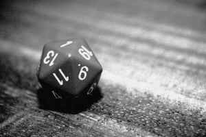 black and white photo of 20-sided die showing a 1