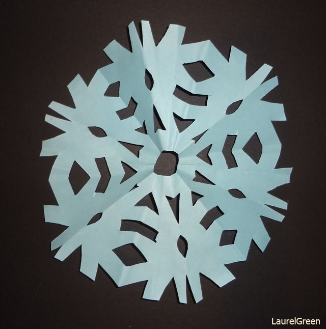 a photograph of a paper snowflake