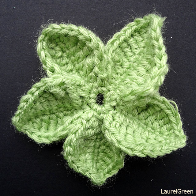 a photo of some crocheted leaves