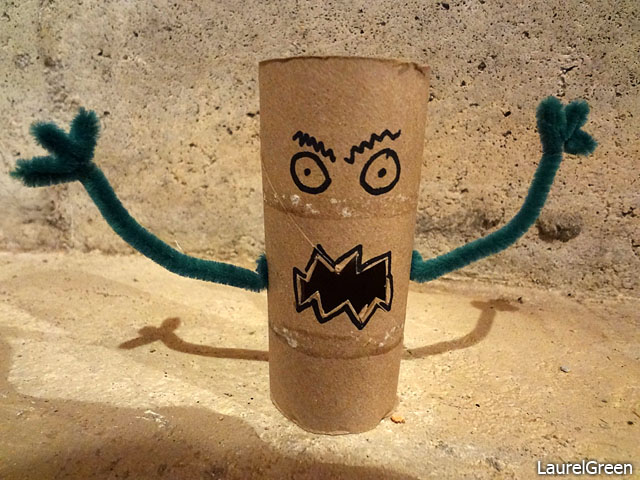 a photo of a monster constructed out of a toilet paper roll