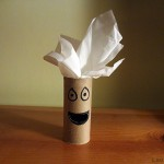 a photo of a toilet paper roll with a face drawn on it