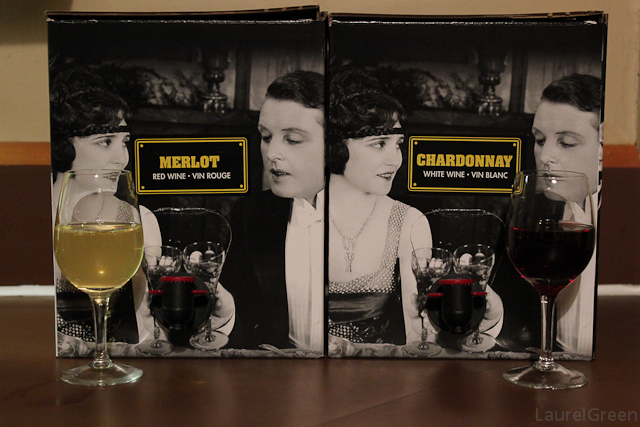 a photo of some boxes of merlot and chardonnay wine in boxes with glasses of wine in front of them