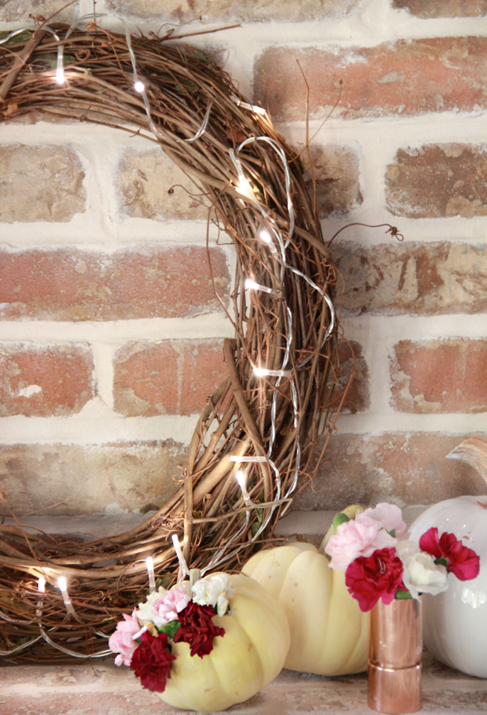 this grapevine wreath can take you from fall to thanksgiving to christmas easily you can keep it up from september to january