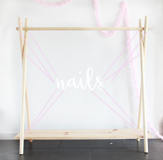Make a criss-cross shape with the wider dowels. Two on each side. Nail the  criss cross parts together. (also, we used multiple nails for each section,  ...