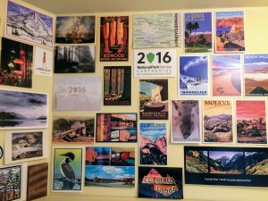 My desk is in a closet that I've decorated with postcards, a portable and inexpensive souvenir. Many are from our travels to national parks.