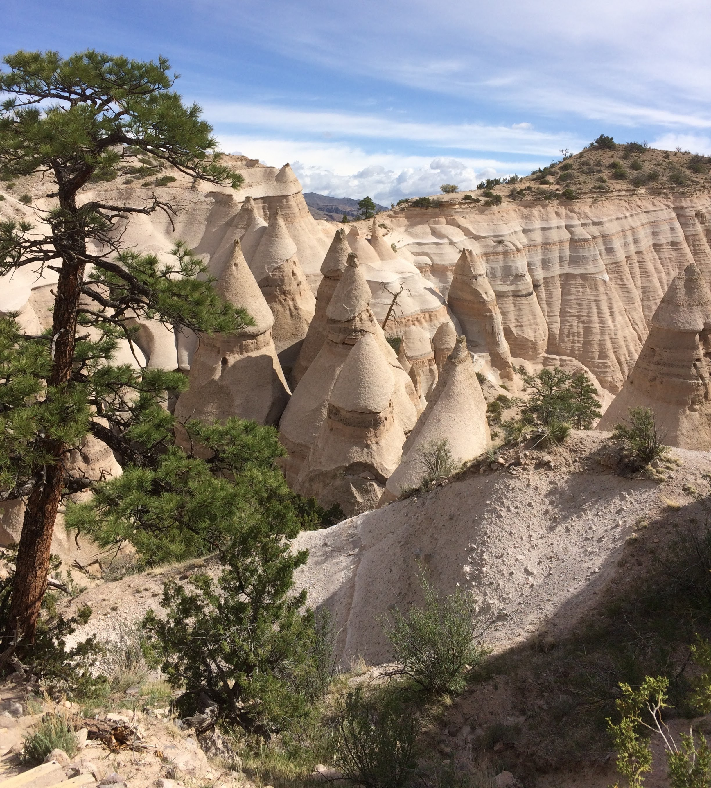 A cluster of tent rocks along the slot canyon trail