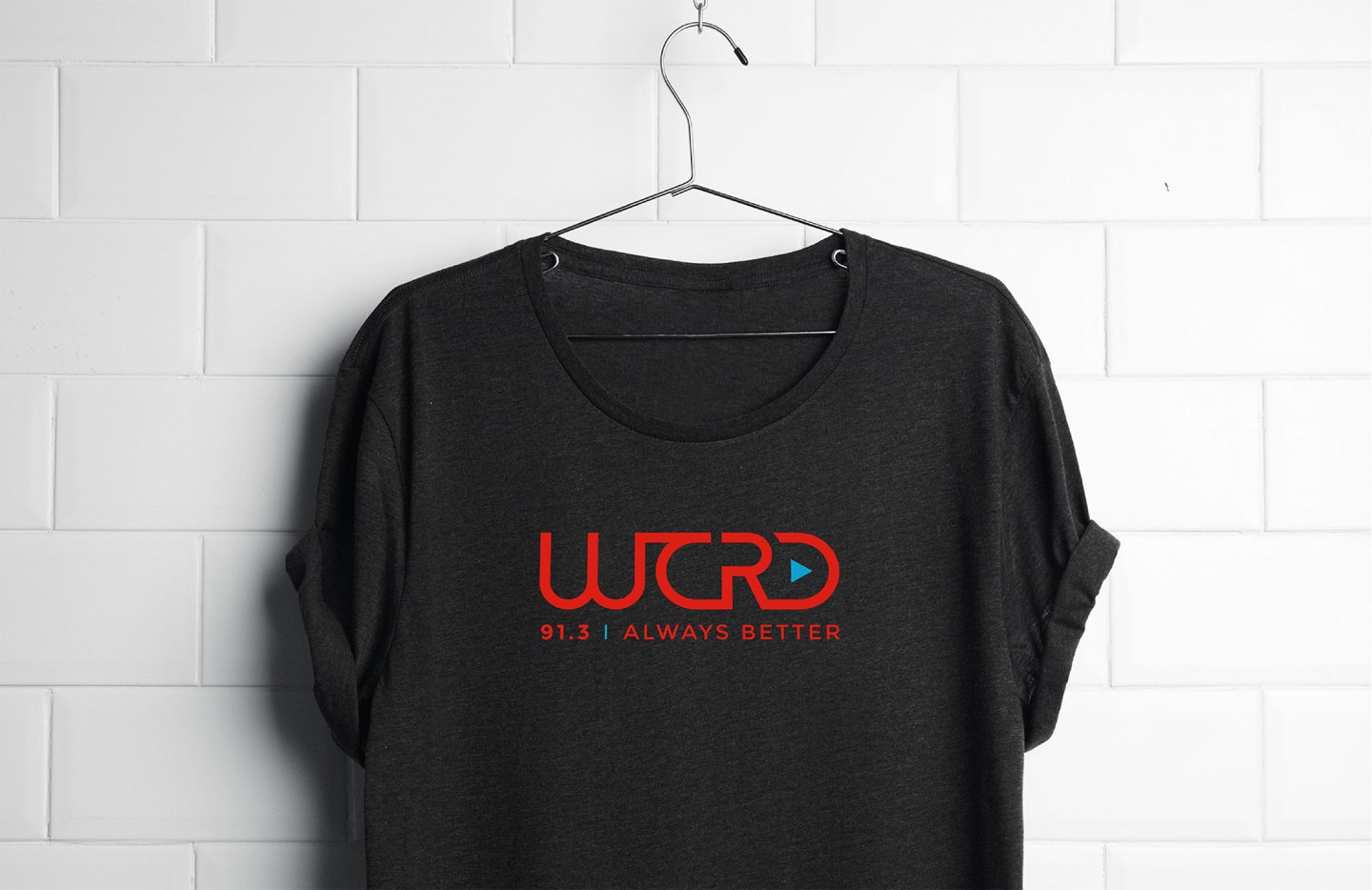The WCRD primary logo lockup on a gray t-shirt