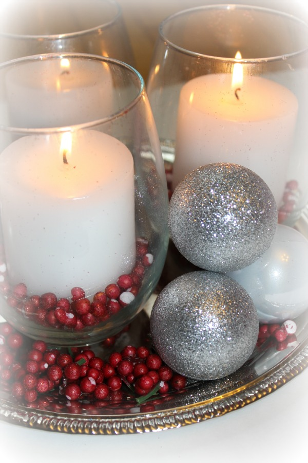 It seems like many Christmas themed centerpieces are SO overpriced!  Here is a quick and easy centerpiece that you can make for under $12.00 - al with supplies from the Dollar Store! Click on picture for tutorial.