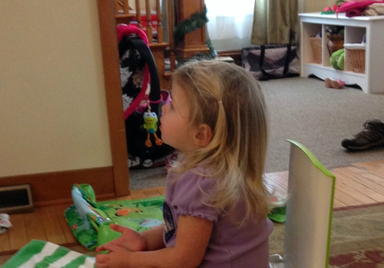 sitting on her potty seat