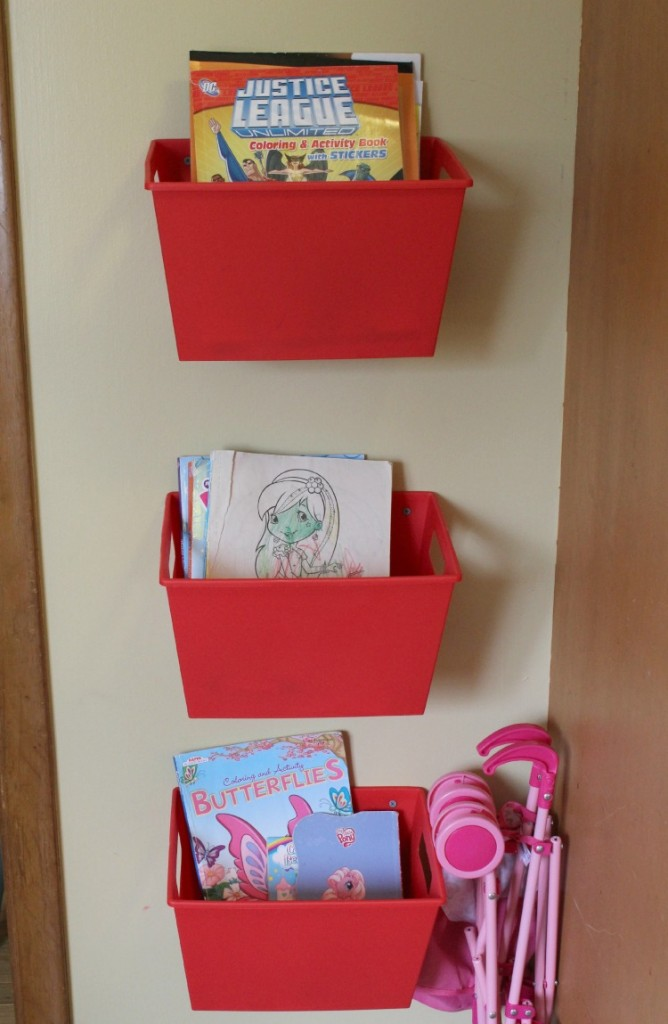What a great idea! Screw plastic organizing bins into the wall to hold coloring supplies!