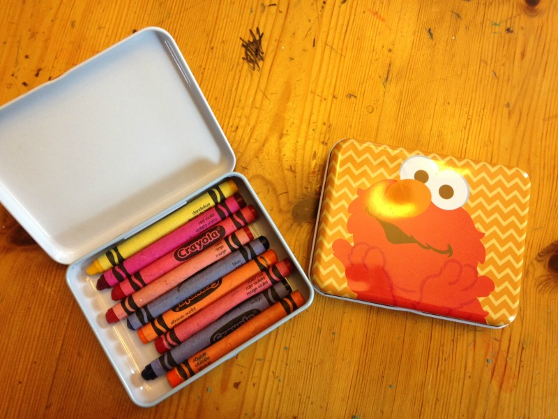 Using tins as crayon holders is a great way to keep the kids from fighting over crayons.