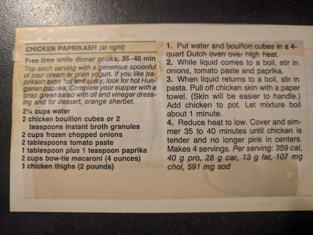 a clipping of a chicken paprikash recipe on a note card