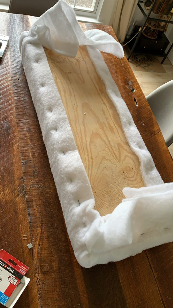 stapling batting to foam and plywood to upholster a bench cushion
