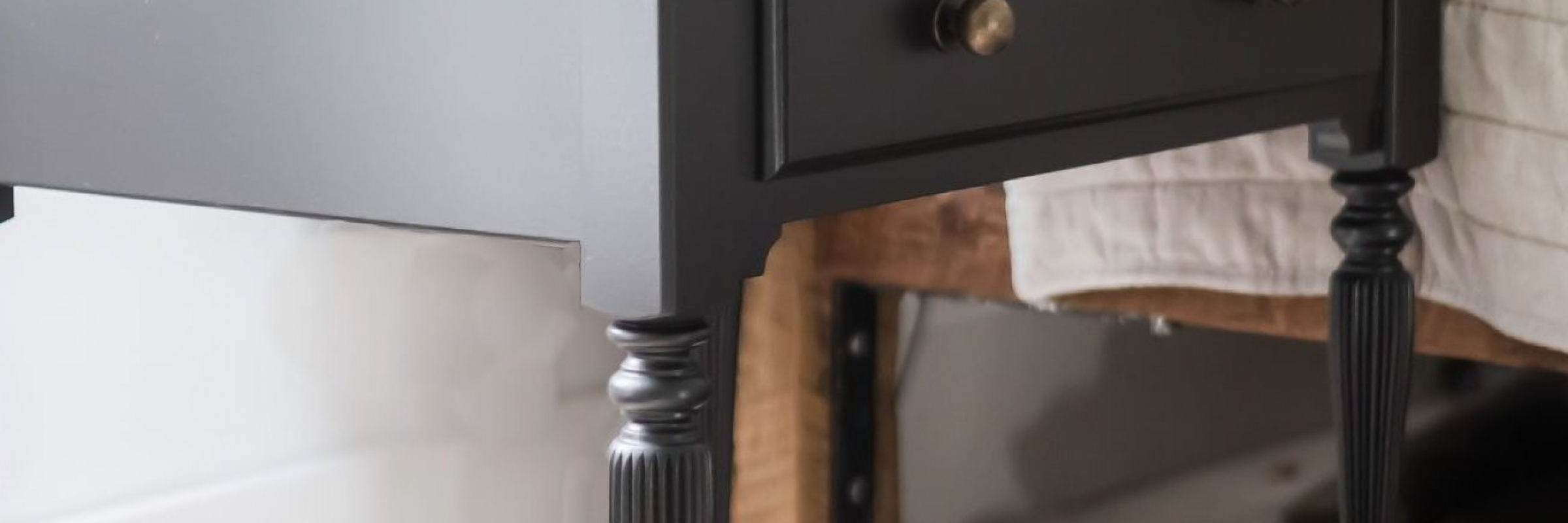 Refinished Chris Loves Julia inspired black nightstands. Deglossed, sanded and painted with Sherwin Williams Caviar.