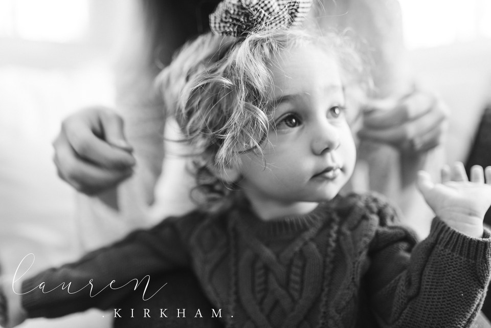 Lauren Kirkham Photography holiday lifestyle session at Christmas family snuggles on couch NY photographer