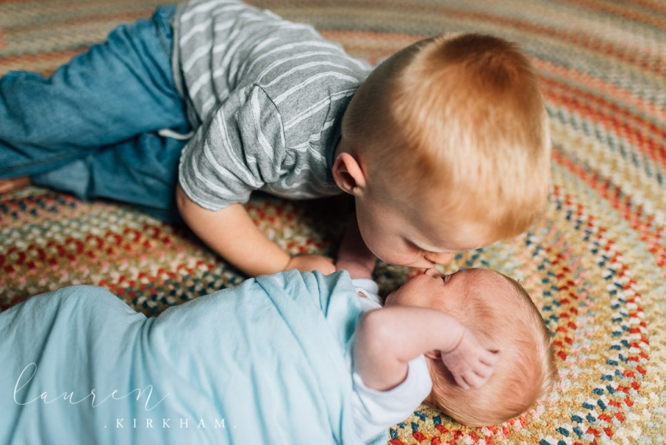big brother during newborn session with Lauren Kirkham Photography