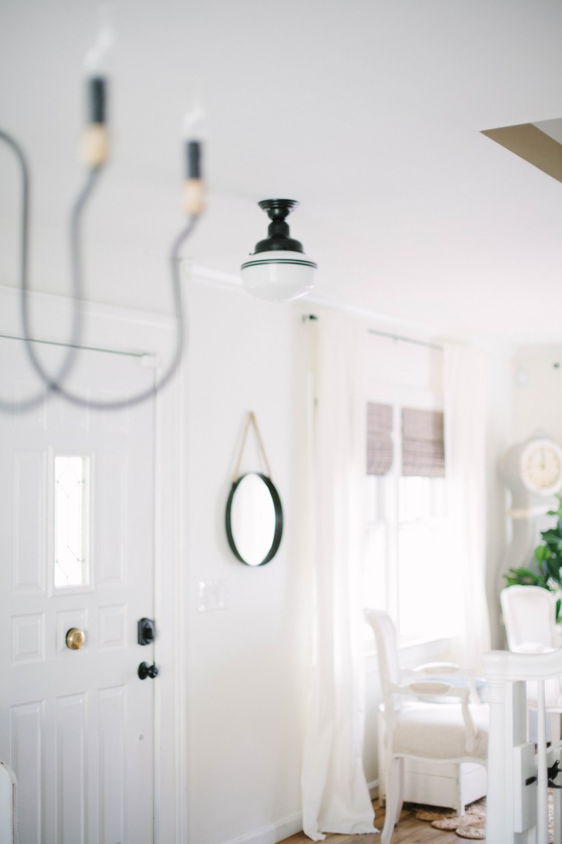 Four simple tips on How To Define Your Foyer Space that are easy inexpensive. Adding some statement lighting offers high impact!