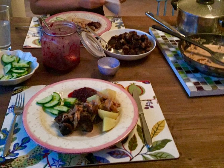 A table set with plates of Swedish meatballs