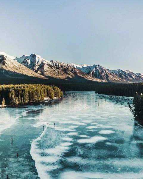 aerial view of skating on frozen Johnson Lake, Banff - Lauren's Lighthouse