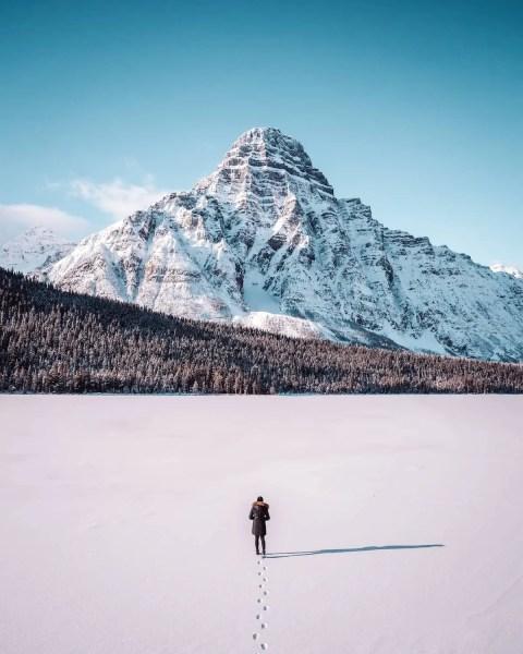 Waterfowl Lake, Icefields Parkway clear snow winter shot, girl walking on lake