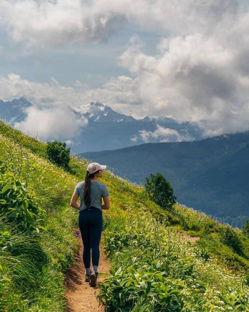 Girl on Mount Cheam trail among luscious greenery