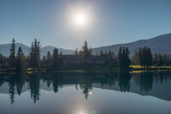 Jasper Park Lodge reflected on Lac Beauvert on summer morning