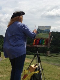 Carole painting a demo on Day Three - see how windy it was?